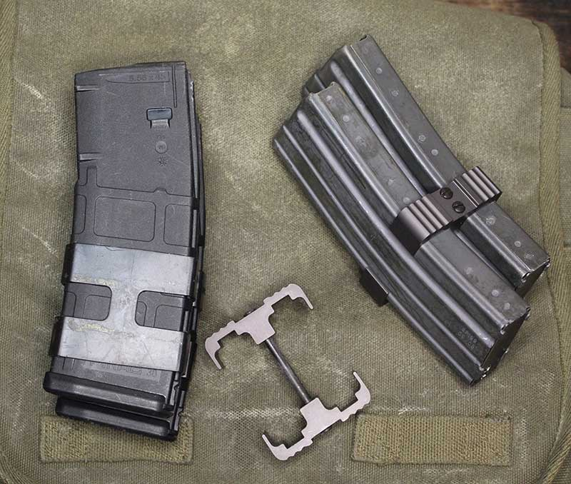 Two double magazine clamps: First Samco on the left and Thor Defense center and right.