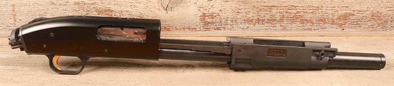 Beating heart of Mossberg FLEX TLS system is an otherwise unadorned slide-action shotgun frame.