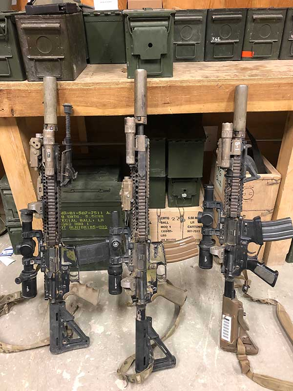 Three carbines outfitted with LPVOs and offset red dots, perfectly set up to handle how the enemy prefers to fight in Afghanistan—at a distance. Offset red dots offer CQB capability if needed.