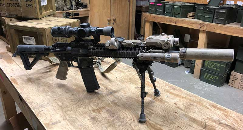 Suppressed M4A1 sports Vortex LPVO, EOTech MRDS, LA-5 laser, and Insight white light. With bipod, this set-up gives user best chance of hitting targets at extended ranges, while offset red dot makes carbine practical for use against close-range threats.