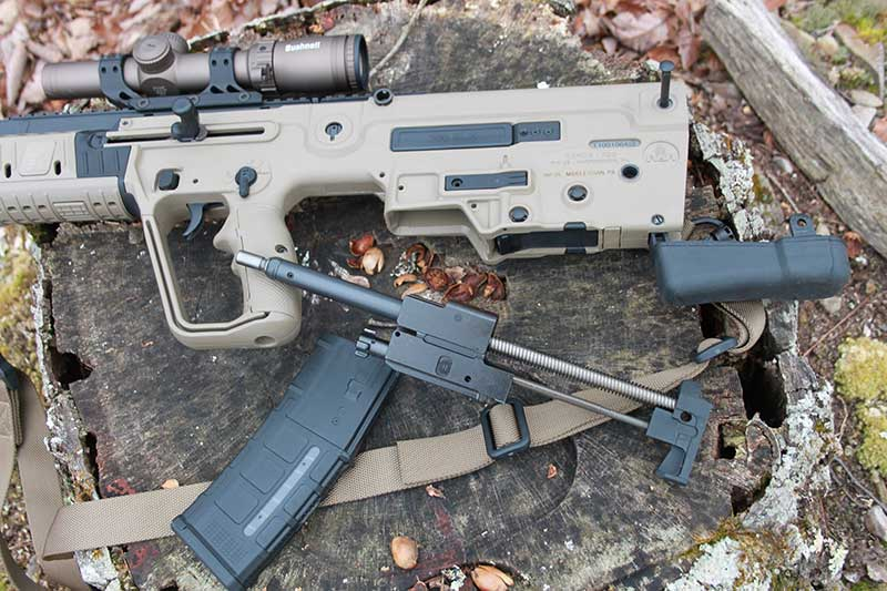 IWI Tavor X95 disassembles quickly with long-stroke gas piston and bolt group removed by unhinging rifle's buttstock and pulling out bolt group assembly.