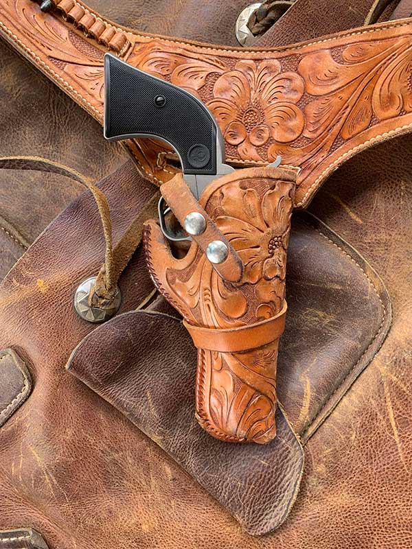 Silver Wrangler in hand-tooled belt and holster.