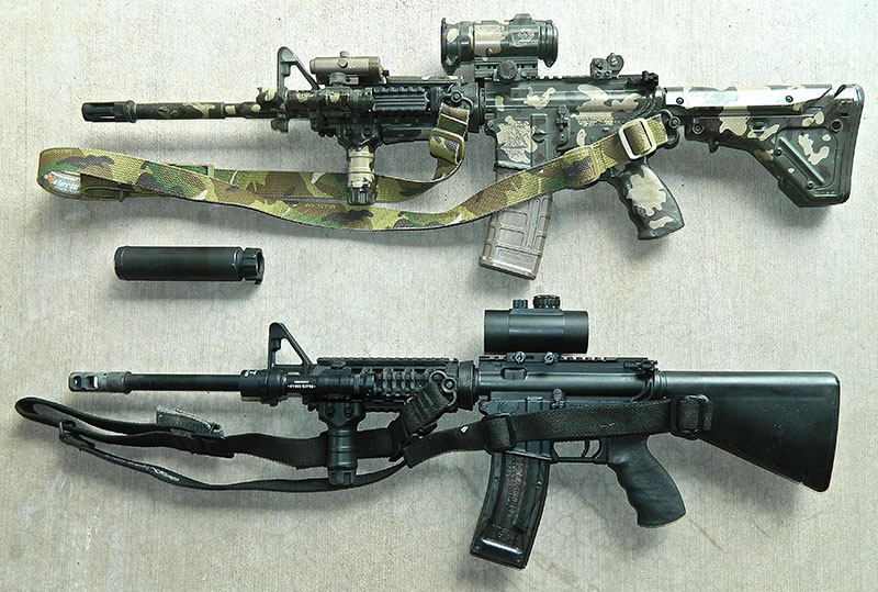 Author's .22 Olympic Arms subcaliber trainer (bottom) is set up exactly the same as his Bravo Company work gun, with the exception of a cheap red dot sight instead of an Aimpoint. They can use the same SureFire suppressor.