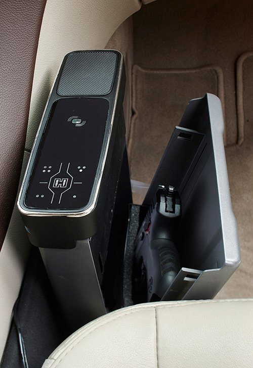Hornady RAPiD Vehicle Safe mounted in vehicle with lid open showing presentation of handgun. For easy access, RAPiD Vehicle Safe presents handgun as lid opens. RAPiD Safe is designed to fit duty-size or smaller handguns. Photo: Hornady