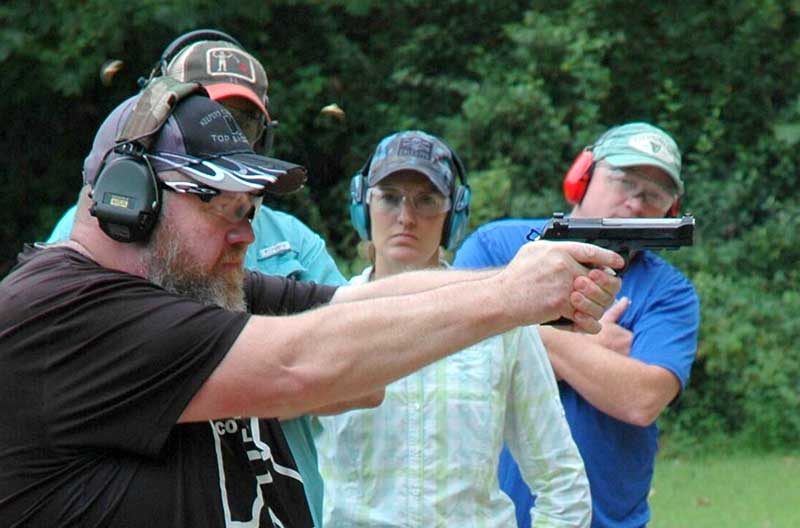 Spencer Keepers fires fast pair at target. Note control over recoil. Keepers emphasizes very strong grip.