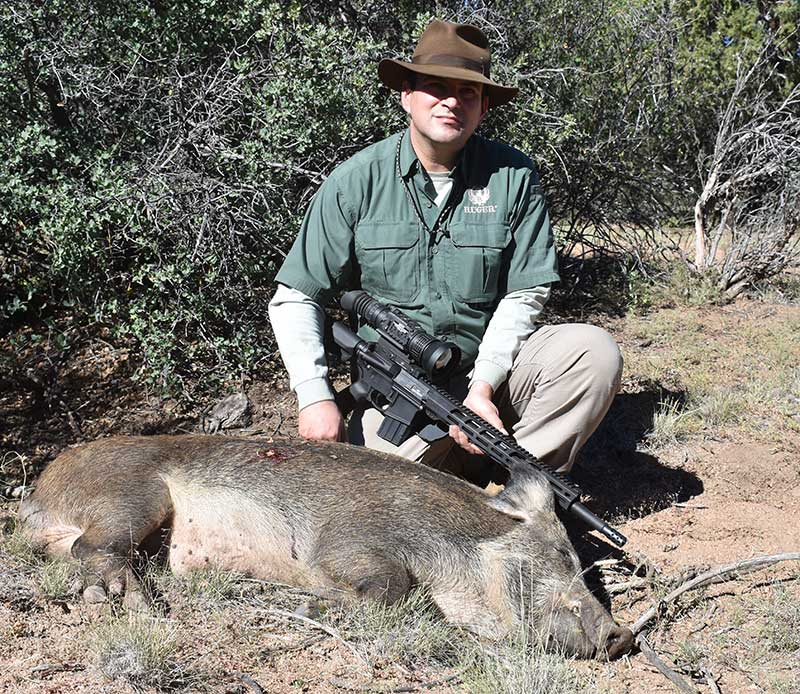 Brandon Trevino with feral boar taken with Ruger AR-556 MPR in .450 Bushmaster.