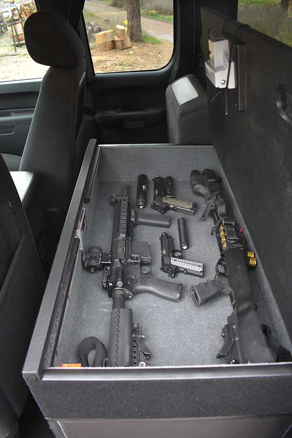TruckVault stores guns, ammo, mags, and more on top …